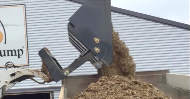 Virnig High Dump Bucket dumping dirt into truck